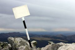 Signpost At The Top Of The Mountain With Copyspace Royalty Free Stock Photo