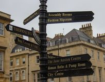 A Signpost in Bath, England. Guiding tourists to all the major attractions stock photos