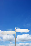 Signpost in blue sky Stock Photos