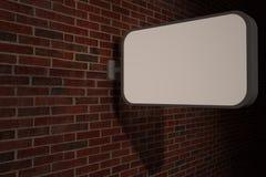 Signpost on brick wall Stock Photo