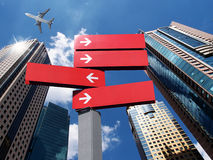 Signpost and buildings Royalty Free Stock Photo