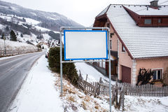 Signpost with copy space in Austrian village at mountains Stock Photos