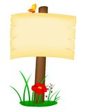 Signpost with copy space. Cartoon illustration of sign with copy space on patch of green grass with red flower, isolated on a white background Royalty Free Stock Photography