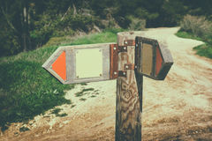 Signpost in countryside landscape. image is retro filtered with faded style . Stock Image