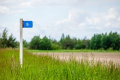 Signpost in countryside landscape. image is retro Royalty Free Stock Image