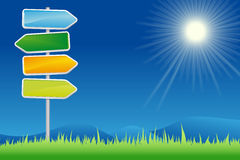 Signpost in der Sommerlandschaft Stockbilder