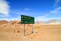 Signpost at the desert road side near Salar de Aguas Calientes salt flats and Sico PassPaso Sico, Chile. Signpost at the desert road side near Salar de Aguas stock images