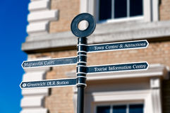 Signpost with destinations in London. Metalic signpost with four directional signs to different destinations in London Royalty Free Stock Photography