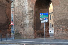 Signpost direction and ancient wall in Rome Royalty Free Stock Photo