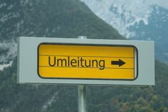 Signpost diversion with mountains in the background royalty free stock photos