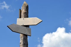 Signpost, in english, blank arrows. Signpost in reference to frequently asked questions Stock Photo