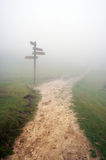 Signpost with fog. And a pathway stock image