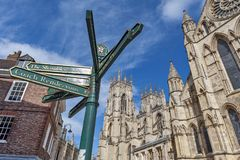 Signpost in front of York Minster, gothic cathedral and major tourist landmark of the City of York in England, UK stock photography