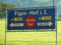 Signpost at Fugenhart Station Austria. A station sign post at Fugenhart in the Tyrol, Austria, taken in the summer Stock Photos
