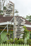 Signpost in a garden in Tonga Royalty Free Stock Images