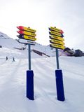 Signpost giving directions to different ski slopes Stock Images