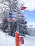 Signpost giving directions to different ski slopes Stock Photography