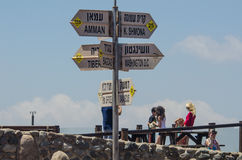 A signpost on the Golan Heights. A signpost in English and Hebrew on Mount Ben Tal close to the Israeli border with Syria on the Golan Heights shows the distance Royalty Free Stock Photos