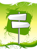 Signpost on green background Stock Photo