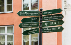 Signpost with a Group of Signs in the Historic Center of Tallinn Royalty Free Stock Image