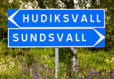 Signpost for Hudiskvall and Sundsvall. Swedish signpost for directions to the two towns Hudiksvall and Sundsvall Stock Image