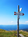 Signpost in Italian mountains. A tourist signpost showing directions in the Apennines Stock Image
