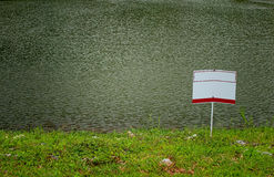 Signpost and the lake Stock Images