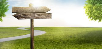 Signpost in landscape. With narrow country road stock photo