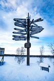 Signpost with lots of directions to go to Stock Photo