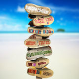 Signpost is made of old worn shoes Stock Image