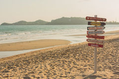 Signpost made of wood with the on the tropical beach. Royalty Free Stock Image