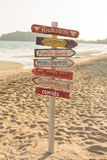 Signpost made of wood with the on the tropical beach. Stock Photography