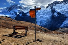 Signpost at Matterhorn Switzerland with directions to various hi Stock Photography