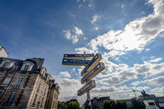 A signpost in the middle of a street. Stock Images