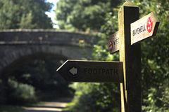 A signpost on the monsal trail. An image of a signpost on a walkway stock photos