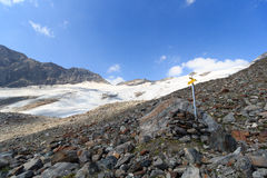 Signpost and mountain glacier panorama, Hohe Tauern Alps, Austria Stock Photo