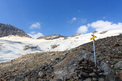 Signpost and mountain glacier panorama, Hohe Tauern Alps, Austria Royalty Free Stock Photos