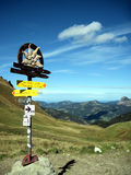 A signpost and mountains Royalty Free Stock Image