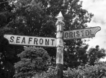 Signpost. An old, rusted signpost in Weston-super-Mare, UK stock photography