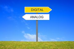 Signpost showing Analogue and Digital german stock images