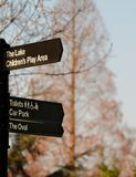 Signpost in park Stock Image