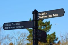 Signpost in park Royalty Free Stock Photography