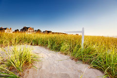 Signpost on path through sand dunes Stock Image