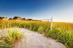 Signpost on path through sand dunes Stock Image