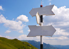 Signpost on path to high mountain Stock Image
