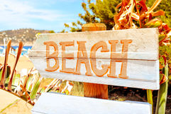 Signpost pointing to the beach in Ibiza Island, Spain, with a fi Royalty Free Stock Image