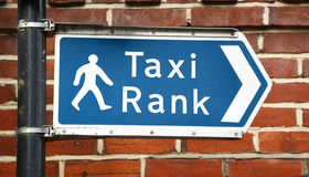Signpost points to a taxi rank Stock Photo