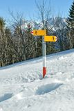 Signpost raising from the deep snow. Next to track close to Turren near Lungern in Switzerland stock photo