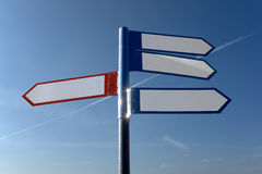 Signpost. With red and blue arrows against the blue sky stock photo