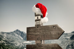 Signpost with Santa Hat Royalty Free Stock Photo